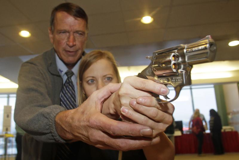 File: Dec. 27, 2012, Cori Sorensen, a fourth grade teacher in Highland, Utah, receives firearms training from personal defense instructor Jim McCarthy during concealed weapons training for 200 Utah teachers.
