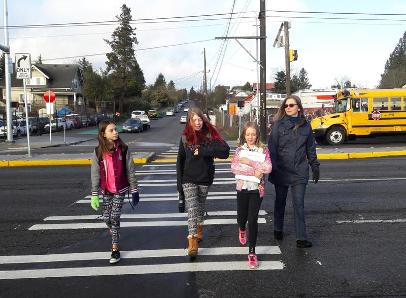 Angel Hackman leads Ruby Oswell (center left) and her friends across Aurora's new crosswalk at 92nd on their way to school.
