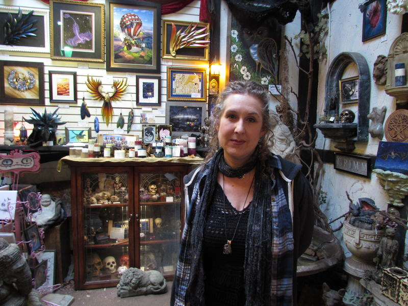 Gayle Nowicki owns Gargoyles Statuary in Seattle's University District. She says small businesses are already closing due to taxes and zoning changes.