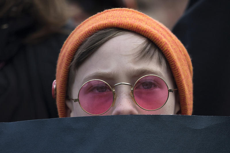 Orion Evans, 10, listens to speakers during a rally before March For Our Lives Seattle on Saturday, March 24, 2018, at Cal Anderson Park in Seattle.