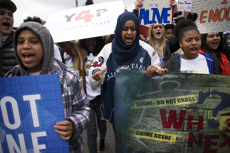 Naj Ali, 17, center, marches on Saturday, March 24, 2018, during March For Our Lives in Seattle.
