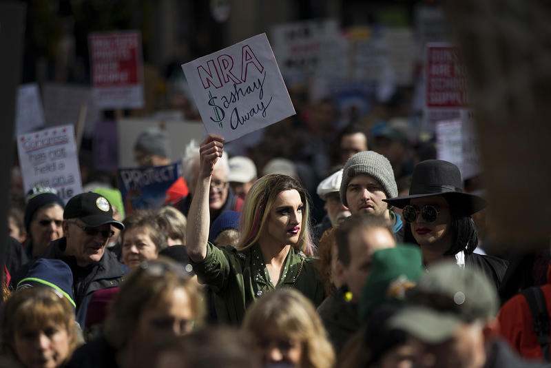 "Jesse Pettibone, 23, center, marches on Saturday, March 24, 2018, during March For Our Lives in Seattle. youth, queer people and people of color are often the victims of gun violence and we need to disarm that hate now,"" Pettibone said."