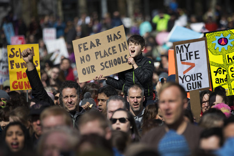 Elliot Schoenholz, 9, center, cheers during a rally following March For Our Lives Seattle on Saturday, March 24, 2018, in Seattle.