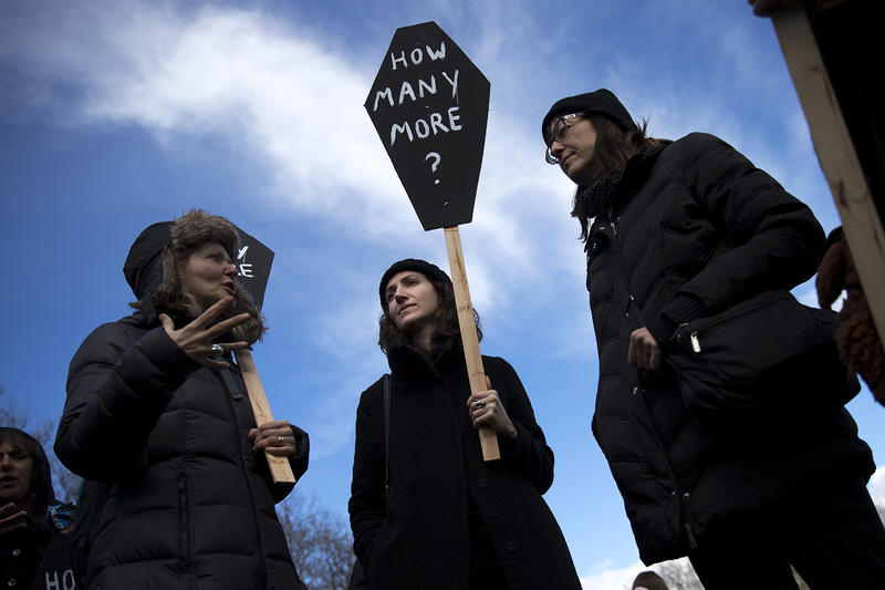 From left, Anne Siems, Andrea Allsop and Andrea O. stand during a rally following March For Our Lives Seattle on Saturday, March 24, 2018, in Seattle.