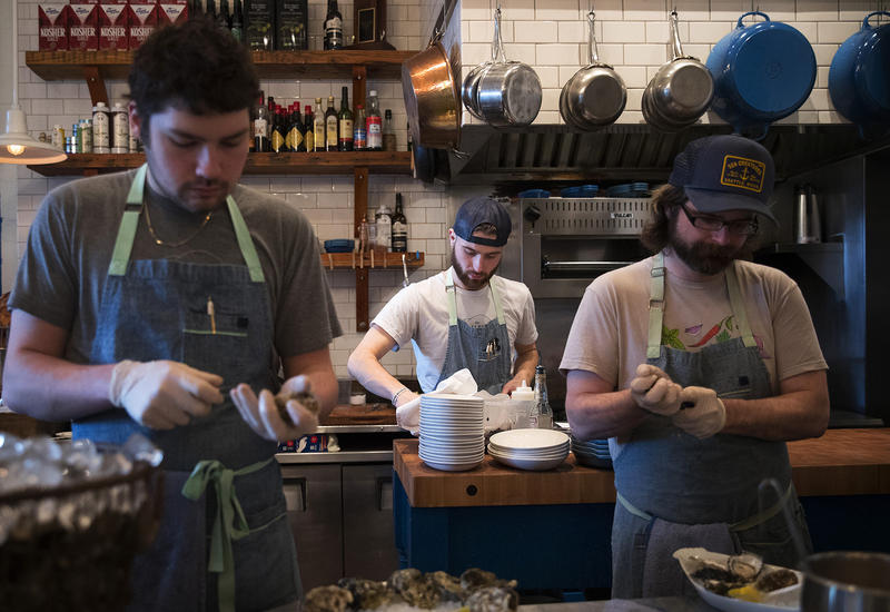 From left, Damian Bogas, Evan Potter and Keegan Obrien work on Sunday, March 4, 2018, at the Walrus and the Carpenter in Seattle.