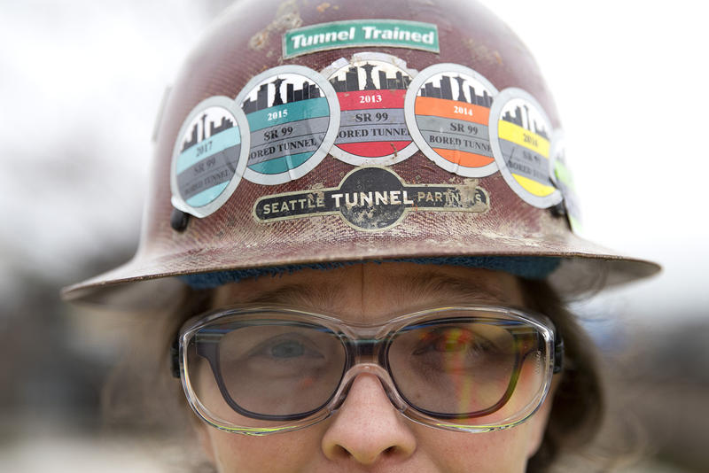 Safety representative for the Seattle Tunnel Partners, Marisa Roddick, wears stickers on her helmet for each year that she has worked on the tunnel project, from 2013 to 2018, on Tuesday, March 27, 2018, in Seattle.