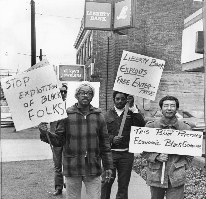 Picketers protest in front of Liberty Bank in 1972 'selective lending' practices