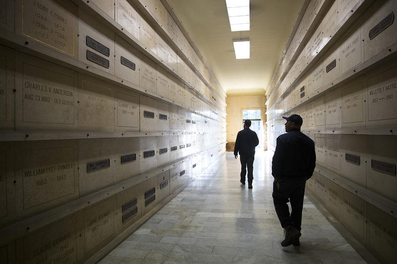 Operations Lead Aaron Sholes, left and Working Foreman Damaso Garcia, right, walk in the Washelli Mausoleum on Thursday, March 1, 2018, at Evergreen Washelli Cemetery in Seattle.