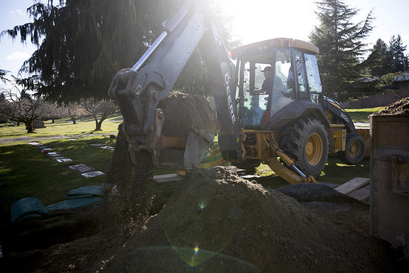 Damaso Garcia removes dirt for a grave on Thursday, March 1, 2018, at Evergreen Washelli Cemetery in Seattle.