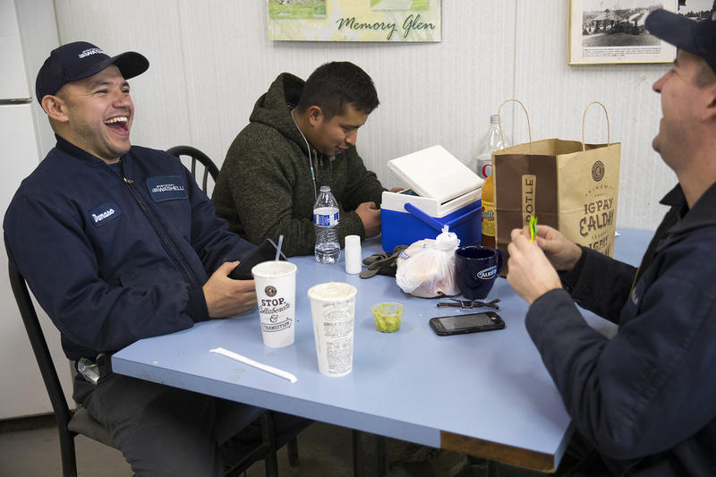 From left, Damaso Garcia, Jose Martinez and Justin Ducette laugh during a break on Thursday, March 1, 2018, at Evergreen Washelli Cemetery in Seattle.