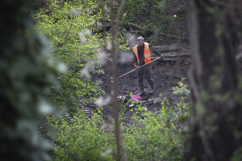Crews remove belongings that were left behind after the Ravenna encampment was cleared, on Wednesday, April 18, 2018, in Seattle.