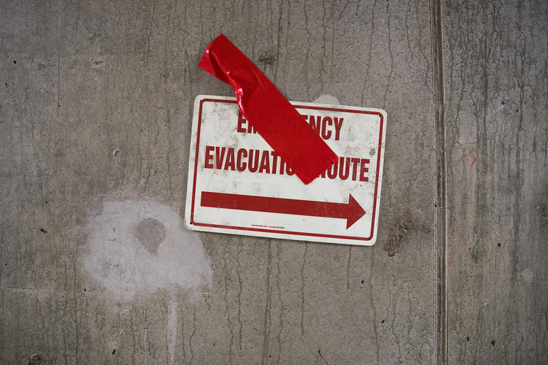 An Emergency Evacuation Route sign is shown on Tuesday, March 27, 2018, inside the SR 99 tunnel in Seattle.