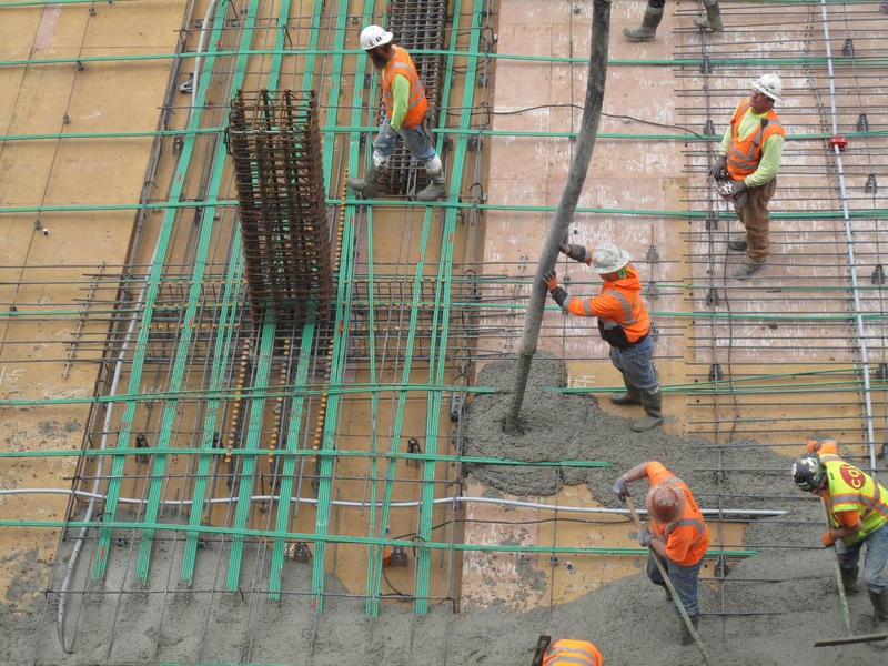 Workers pour concrete for a floor of an office tower in Renton. Pouring concrete carries a lot of risk for workers.