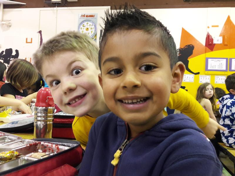 Kindergartners Coah Wilson and Gannon Meyer at lunch at their school in Bellevue.