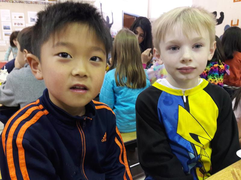 Grant Choi, left and his friend Jack Scholl eat lunch at Puesta del Sol Elementary School in Bellevue.