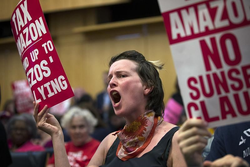 Emily McArthur reacts on Monday, May 14, 2018, during the head tax vote at City Hall in Seattle.
