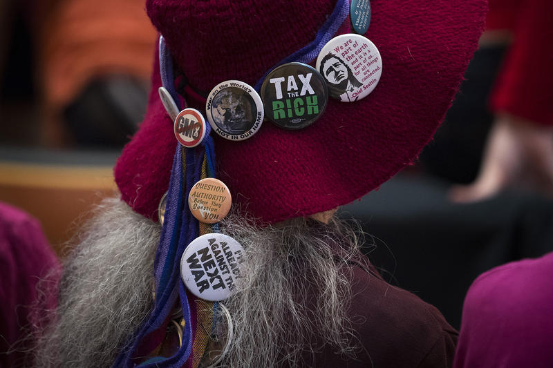 Pins on Renny Reep's hat are shown on Monday, May 14, 2018, during a head tax vote at City Hall in Seattle.