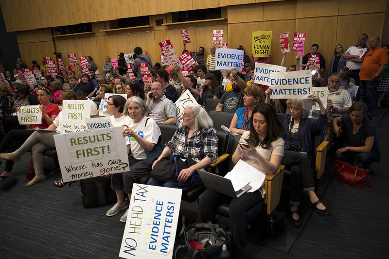 People for and against the head tax gather on Monday, May 14, 2018, at City Hall in Seattle.