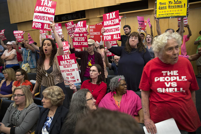 Supporters of the head tax cheer as councilmember Sawant speaks during the head tax vote on Monday, May 14, 2018, at City Hall in Seattle.