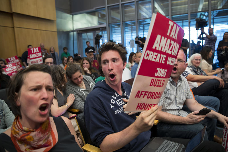 Freeman Ryan, center, reacts on Monday, May 14, 2018, during the head tax vote at City Hall in Seattle.