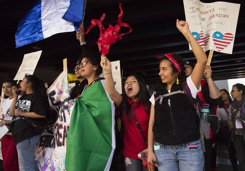Suri Emigdio, 11, second from right, and Rocio Carranza, right, cheer during the annual March for Immigrant and Workers Rights on Tuesday, May 1, 2018, in Seattle.