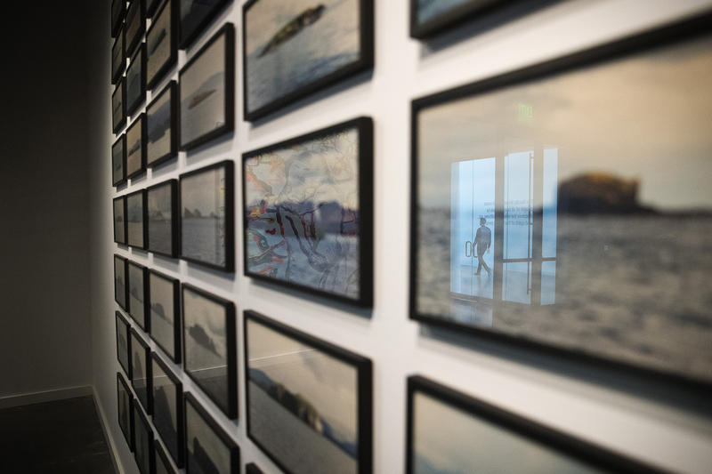 A museum employee is reflected in an image on display inside the Northern Exposure exhibit on Wednesday, May 2, 2018, at the new Nordic Museum in Seattle.
