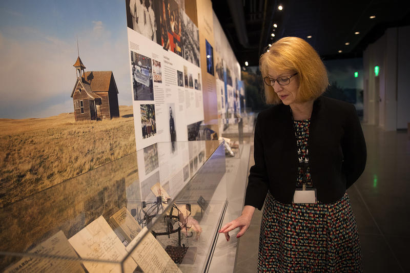 Curator of Special Projects, Nancy Engstrom Zinn, points out an item that she personally donated to the museum, a hymnal for Lutheran Christians in America, on Wednesday, May 2, 2018, at the new Nordic Museum in Seattle.