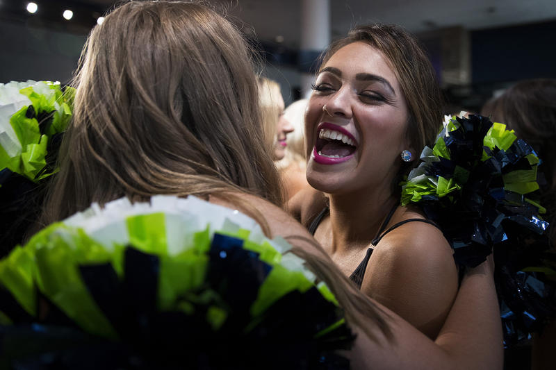 Sea Gals hopeful Frankie, right, celebrates after making the team during the final auditions on Sunday, May 13, 2018, at the CenturyLink Field West Club Lounge in Seattle.