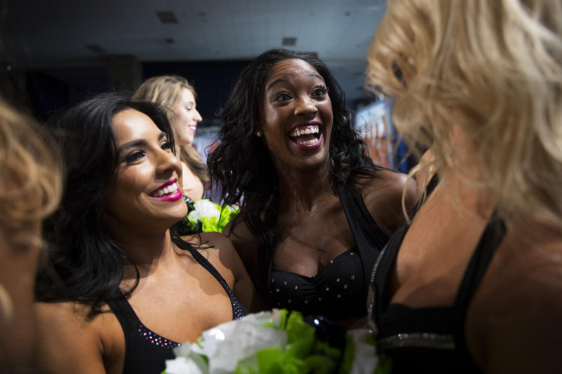 Sea Gals member De'Djuana, center, celebrates with other teammates after making the 2018 squad during the final auditions on Sunday, May 13, 2018, at the CenturyLink Field West Club Lounge in Seattle.