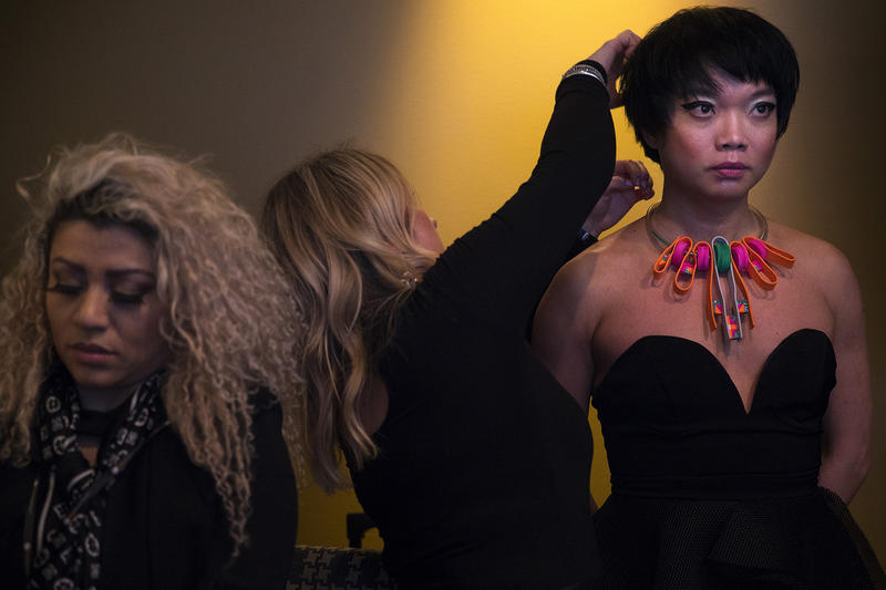 Hair and makeup artist Paula Yahn adjusts Victoria Victor's hair before Fashion Lab Inclusive, an all inclusive fashion show, on Friday, March 30, 2018, at Columbia Tower Club in Seattle.