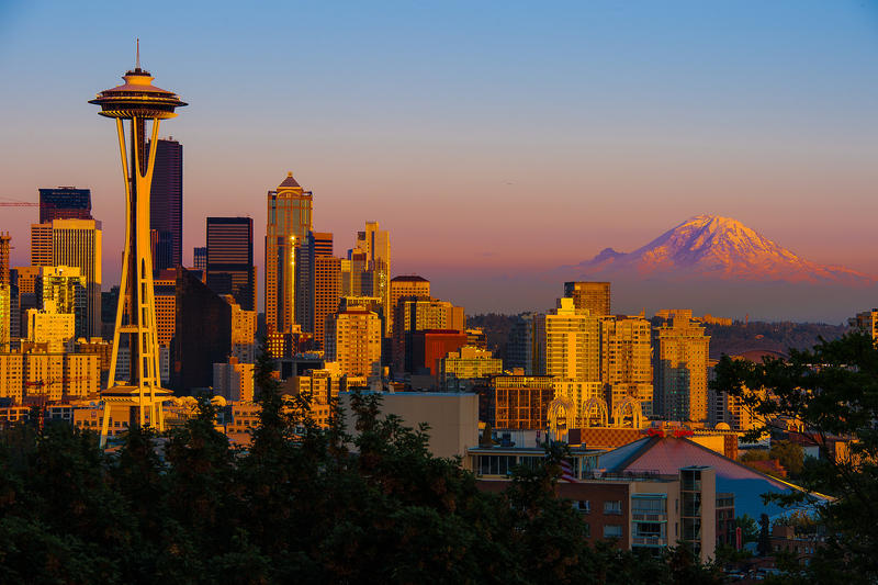 The summer sun sets on Seattle. (Say that ten times fast, preferably while bumping one of these songs.)