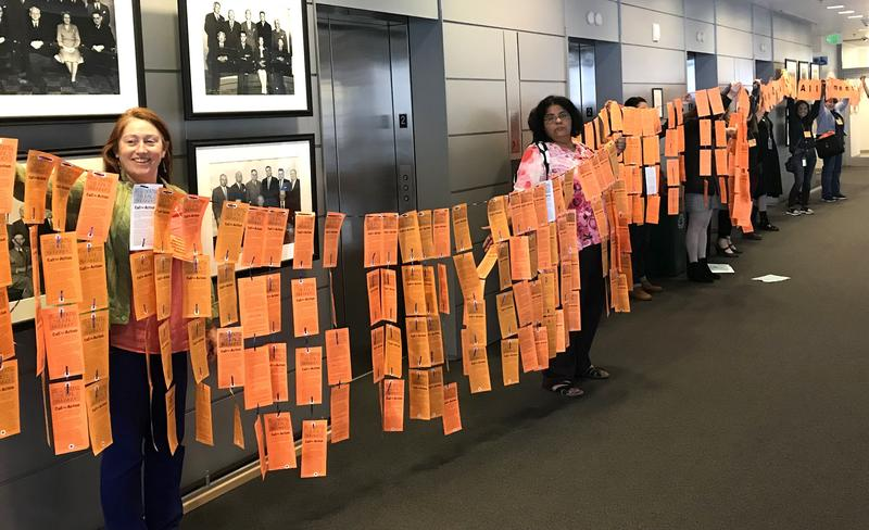Seattle Silence Breakers unveiled postcards and banners Thursday, May 31 2018, that read 'Mayor Durkan, Stop All harassment & Discrimination now!'