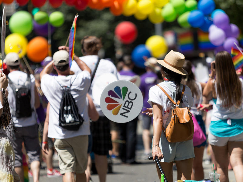 The OUT@Comcast team members and friends marching in the 2017 Seattle Pride Parade, by Stephen Wong.