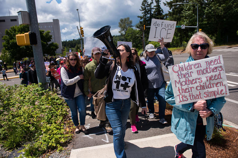 Members of NWDC Resistance chant during the Solidarity Day protest outside of the Federal Detention Center in SeaTac.