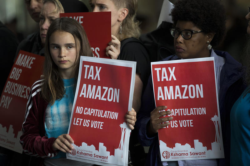 Natalya McConnell, 12, left, and Bri Little, 22, right, stand with council member Kshama Sawant during a rally before the head tax vote on Tuesday, June 12, 2018, at City Hall in Seattle.