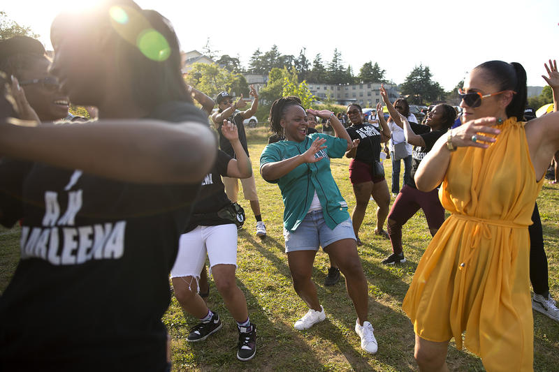 Shakiah Danielson, center, dances with friends and family of Charleena Lyles during the one year remembrance, reflection and healing event on the anniversary of her death on Monday, June 18, 2018, at Magnuson Park in Seattle.