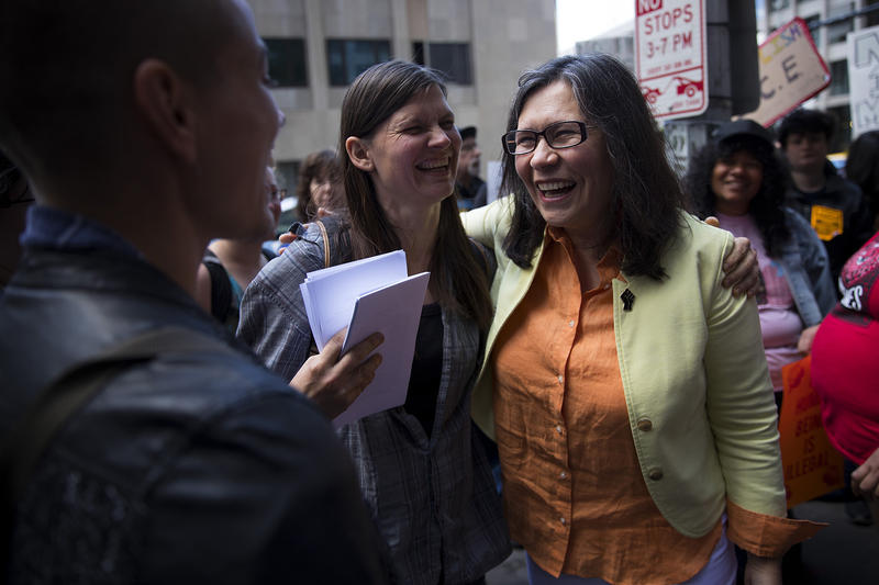 Maru Mora, right, smiles with Murphy Mitchel before her ICE hearing on Tuesday, June 26, 2018, outside of the Immigration Court building on 2nd Avenue in Seattle.