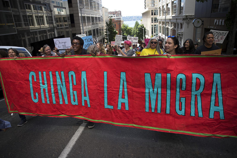 Protesters march on Spring Street after leaving an ICE hearing for Maru Mora on Tuesday, June 26, 2018, outside of the Immigration Court building on 2nd Avenue in Seattle.