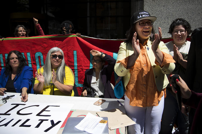 Maru Mora cheers after her ICE hearing on Tuesday, June 26, 2018, outside of the Immigration Court building on 2nd Avenue in Seattle.