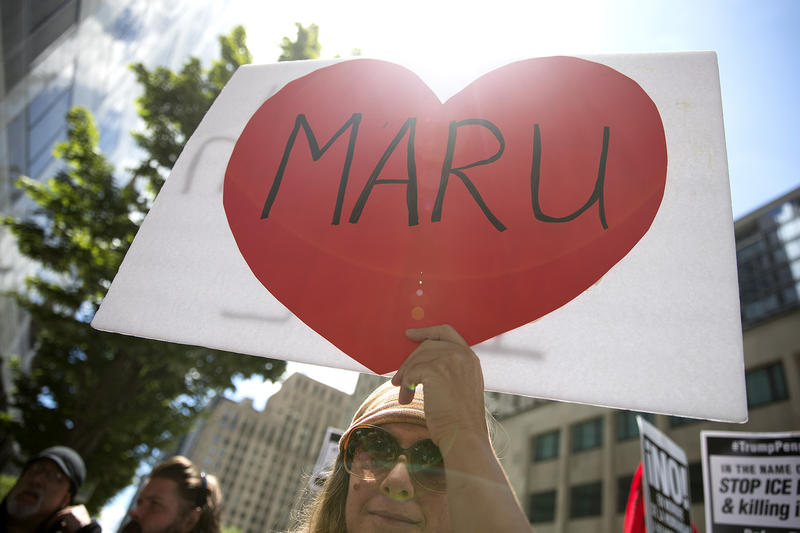 Barbara Hendricks holds a sign showing support for Maru Mora during an ICE hearing on Tuesday, June 26, 2018, outside of the Immigration Court building on 2nd Avenue in Seattle.