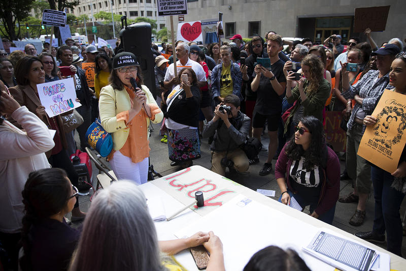 Maru Mora speaks to a large crowd before her ICE hearing on Tuesday, June 26, 2018, outside of the Immigration Court building on 2nd Avenue in Seattle.