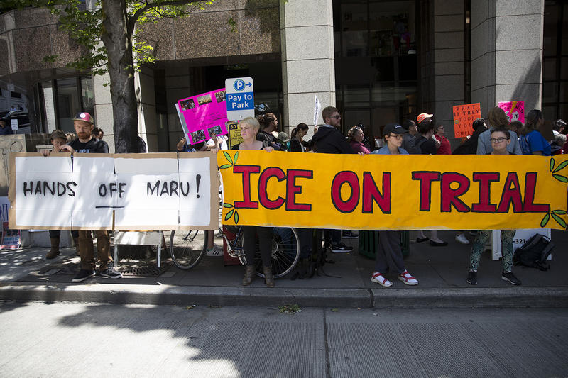 A crowd gathers on Tuesday, June 26, 2018, to show support for Maru Mora during an ICE hearing outside of the Immigration Court building on 2nd Avenue in Seattle.