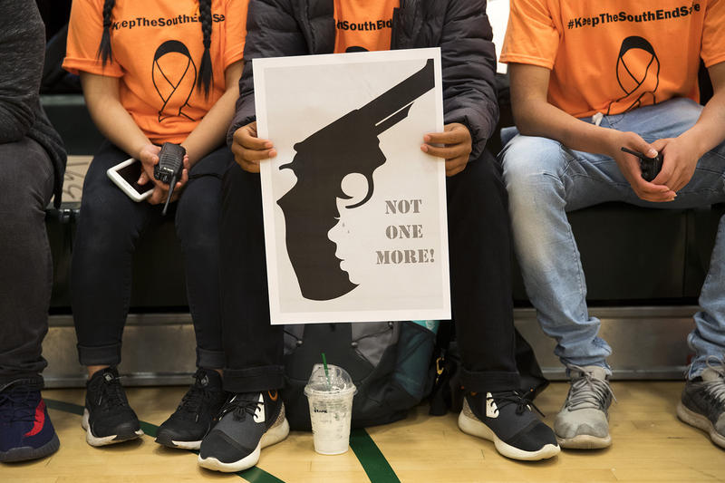 Senior Marc Muñoz, 18, holds a 'Not One More' sign during an assembly on Friday, June 8, 2018, at Franklin High School in Seattle.