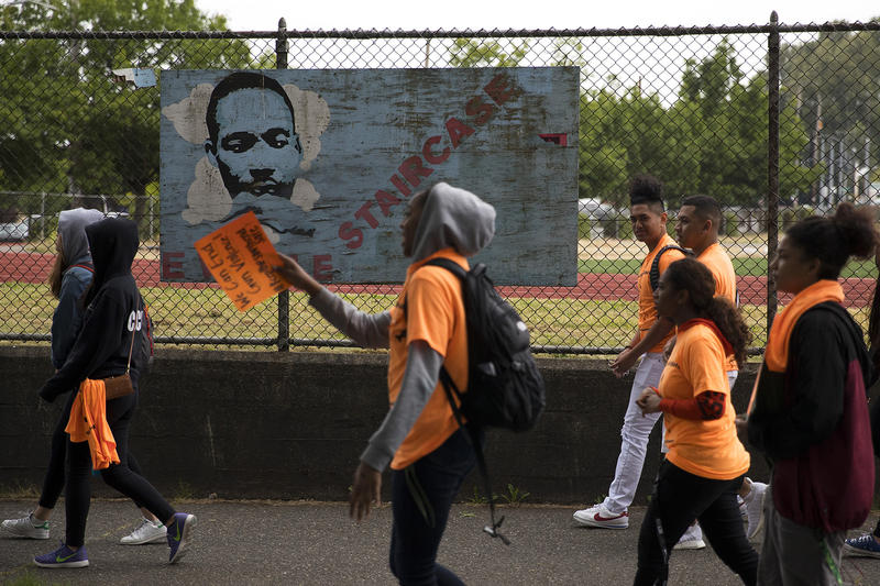 Students walk toward Rainier Ave. South before a demonstration calling for an end to gun violence on Friday, June 8, 2018, outside of Franklin High School in Seattle.