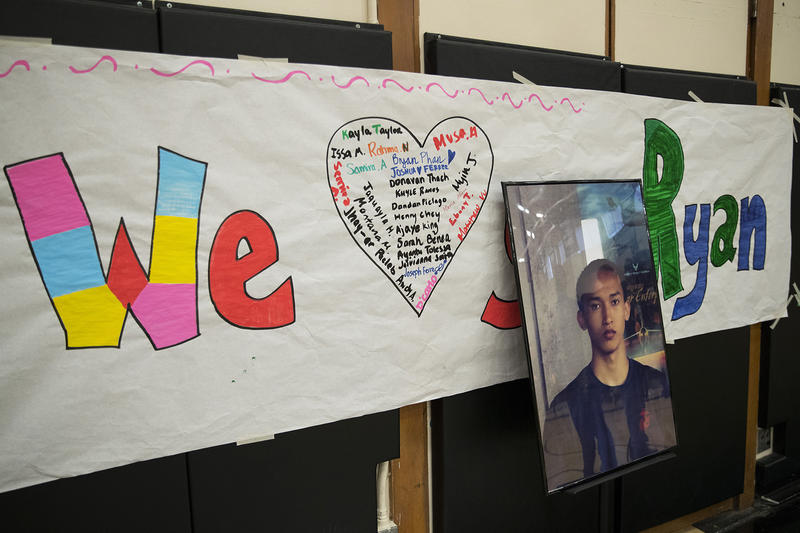 A picture of Ryan Dela Cruz is on display during an assembly on Friday, June 8, 2018, at Franklin High School in Seattle.