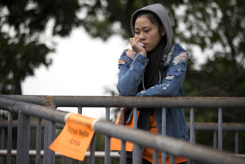Jasmine Nguyen, 18, stands on a bridge overlooking Rainier Ave. South during a demonstration on Friday, June 8, 2018, outside of Franklin High School in Seattle.