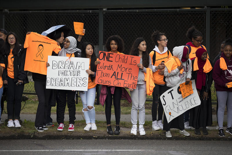 Students gather at the intersection of Rainier Ave. South and Martin Luther King Jr. Way South during a demonstration calling for an end to gun violence on Friday, June 8, 2018, outside of Franklin High School in Seattle.