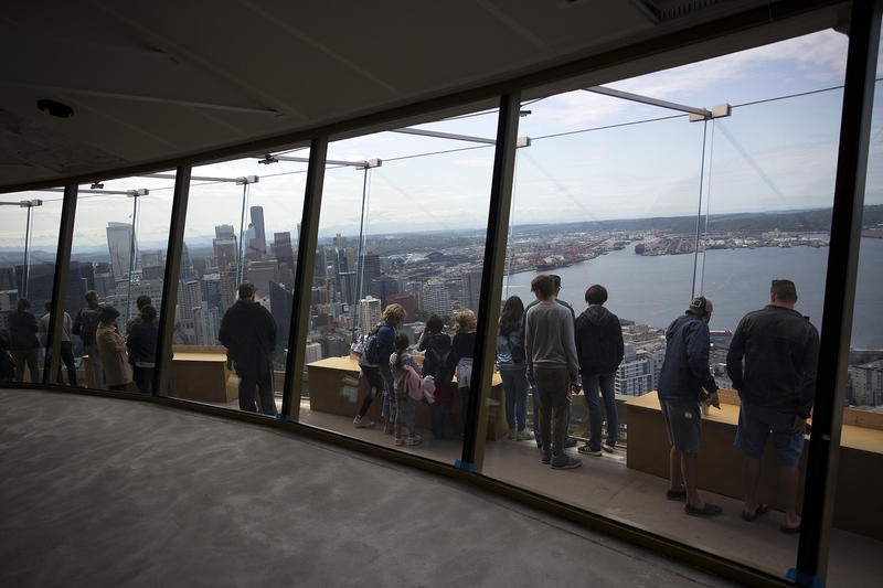 People gather on the observation deck of the Space Needle  on Tuesday, June 5, 2018, in Seattle.