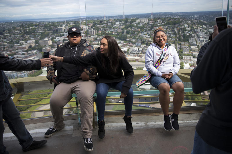 Neesah Kanip, right, has her picture taken on the observation deck on Tuesday, June 5, 2018, at the Space Needle in Seattle.