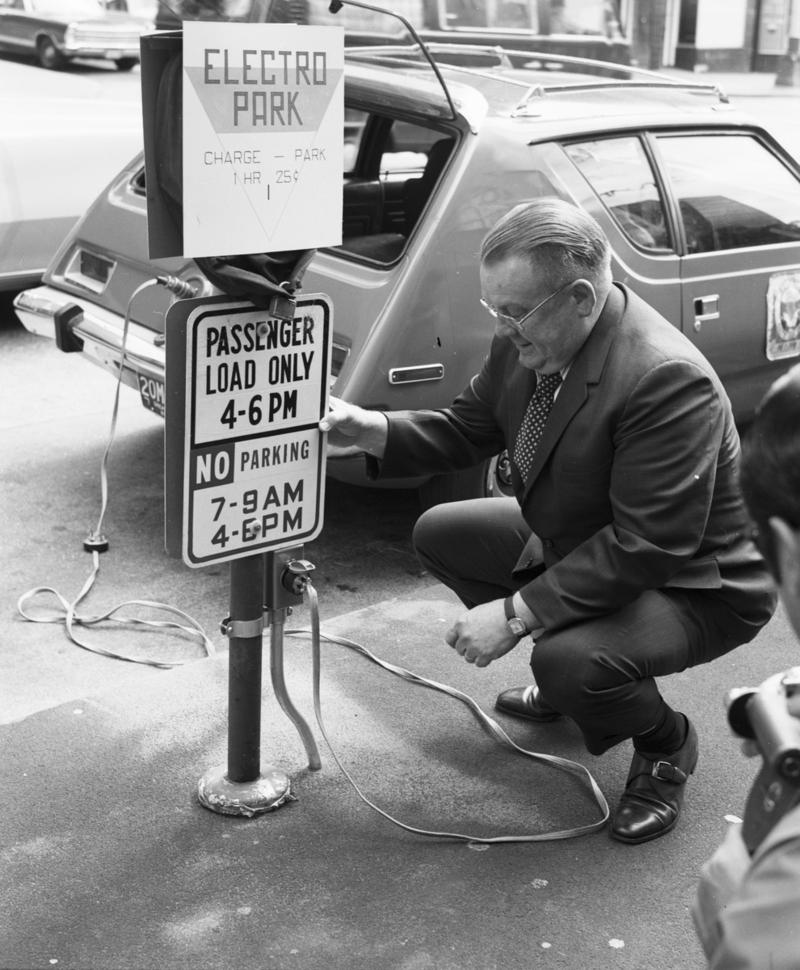 City Light Superintendent Gordon Vickery with a prototype AMC Gremlin electric car, 1973